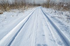 Traces of the car in the snow. The tire tread pattern is visible royalty free stock images