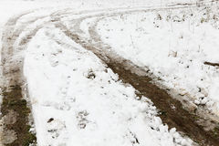 Traces of the car in the snow Royalty Free Stock Photo