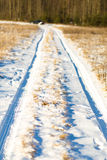 Traces of the car. On a snowy road outside the city Stock Photography