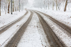 Traces of car tires on the street during heavy snowstorm Stock Image