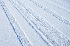 Traces of cars on the snow Stock Image