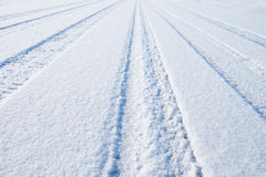 Traces of cars on the snow Stock Photo