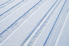 Traces of cars on the snow Royalty Free Stock Photos