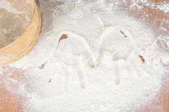 Traces of childrens hands on flour royalty free stock images