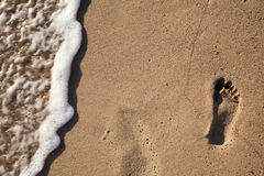 Traces of feet in the sand on the beach Stock Photo