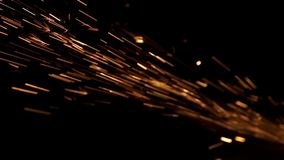 Traces of glowing hot particles in the dark. Slow motion vodeo stock video
