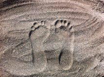 Traces in grey sand. Human traces in grey sand Stock Images