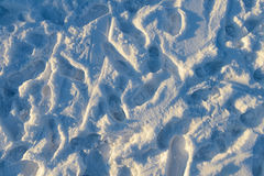 traces of human feet on the snow Royalty Free Stock Photos