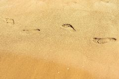 Traces of human legs on sand Stock Photos