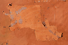 Traces of old announcements on terracotta wall. Background textu Royalty Free Stock Photo
