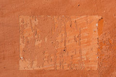 Traces of old announcements on terracotta wall. Background textu Royalty Free Stock Photography