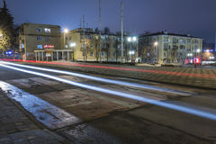 Traces of passing cars on the night street Stock Image