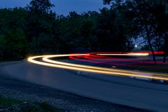 Traffic on the turn at night stock photography
