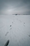Traces of people in the snow-covered surfac Royalty Free Stock Images