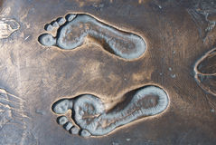 Traces of the person on bronze Royalty Free Stock Photo