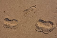 Traces of person on hot sand Royalty Free Stock Image