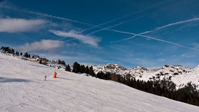 Traces of planes in the sky over the Alps Stock Photo