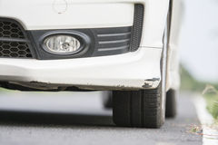 The Traces of plying the front bumper on a white car. Stock Photography
