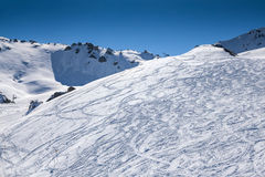 Traces of skiers in mountains Stock Photo