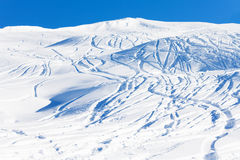 Traces of skis on snow-covered mountain slope Royalty Free Stock Image