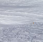 Traces of skis and snowboards in new fallen snow and warning sig Royalty Free Stock Photo