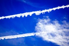 Traces in the sky from flighters Royalty Free Stock Photo