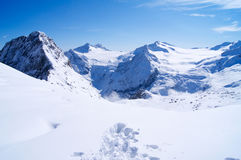 Traces in the snow in the mountains in Italy Stock Photos