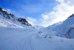 Footprints on the snow in winter mountains Stock Photos