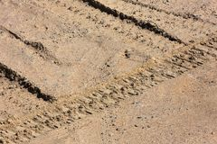 Traces of tire treads on a dry soil surface stock images