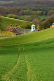 Traces to the clock on a green hill Stock Images