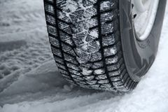 Traces of tread blocks on winter tires under off road vehicle Stock Photo