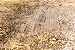 Traces of the wheels of cars and motorcycles on the roads in rur Stock Images