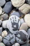 Tracez une main sur la pierre Photo stock