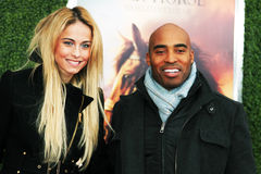 Traci Lynn Johnson und Tiki Barber Stockfotos