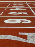 Track. Athletic track with numbers and lines in the start Stock Images