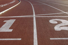 Track. Athletic track with numbers and lines in the start Stock Photo