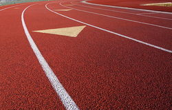 Track. Curve and lanes of a red running track Royalty Free Stock Images