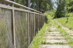 Track along the fence Royalty Free Stock Photo