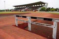 Track and barricade in stadium. Orange track and barricade in stadium Royalty Free Stock Photo
