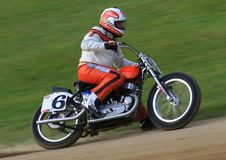 Track bike racing event. Pro racer runs the curve at the racing event Royalty Free Stock Image