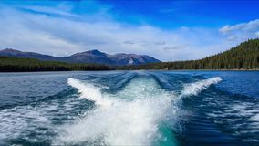 Track from a boat. On the Maligne lake, Alberta, Canada stock footage