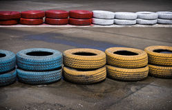 Track border. Fragment of a barrier on a carting track made of an old painted tires Royalty Free Stock Photo