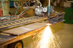 Track Burner. A machine for cutting metal with fire - in a metalworks shop royalty free stock photography