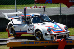 Track commissioners recover a 1976 Porsche 934. Monza circuit was the theatre of the Monza-Historic event by Peter Auto Stock Photo