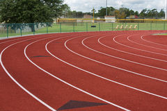 Track Curves. The lanes curve into the straightaway in this image of a local running track royalty free stock images