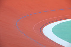 Track Cycling. Bicycle racer flying around a curve in bicycle racing velodrome stock images