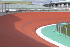 Track Cycling. Bicycle racer flying around a curve in bicycle racing velodrome stock image