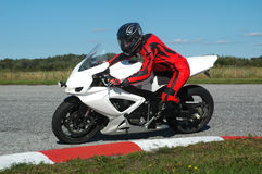 Track day. Riding a bike at a sunny track day on an empty race track Royalty Free Stock Photo