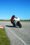 Track day. Riding a bike at a sunny track day on an empty race track Stock Image