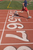 Track Done. A runner crosses the finish line Royalty Free Stock Images